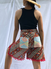 Load image into Gallery viewer, Bulaklak in red wrapped around shorts with yellow beads tassel, pompoms and pockets Xs-M