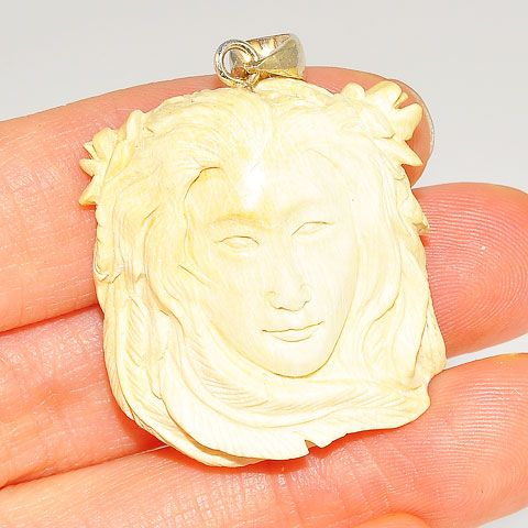 Sterling Silver Carved Mammoth Ivory Face Pendant