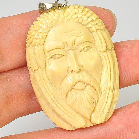 Sterling Silver Fossilized Mammoth Ivory Face Pendant