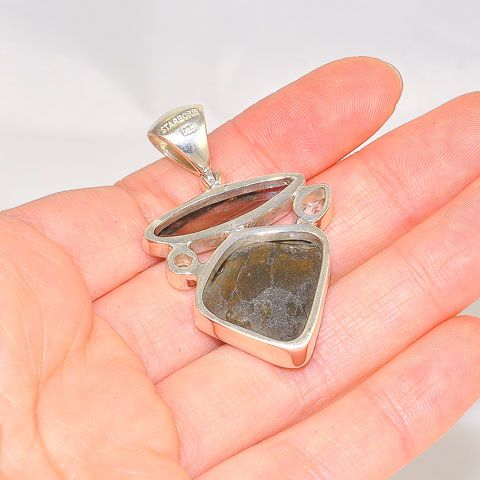 Sterling Silver Fossilized Dinosaur Bone with 4.8 Carats Smoky Quartz and 0.8 Carats White Topaz Pendant