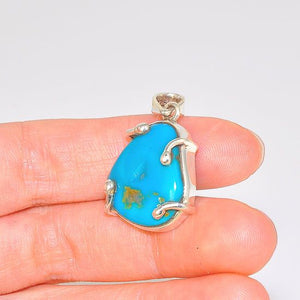 Sterling Silver Sleeping Beauty Turquoise Nugget Wire Held Pendant