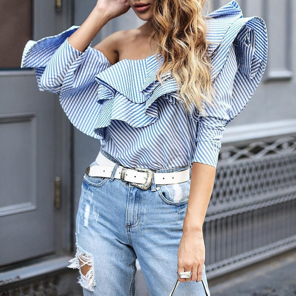A Long Sleeved Shirt With Ruffled Edge And Bare Shoulders