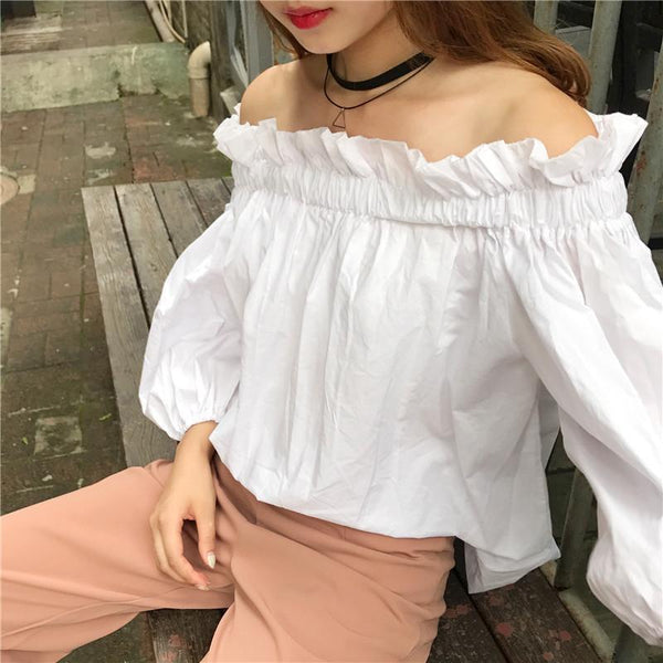 A Strapless Blouse With A Wide Neck