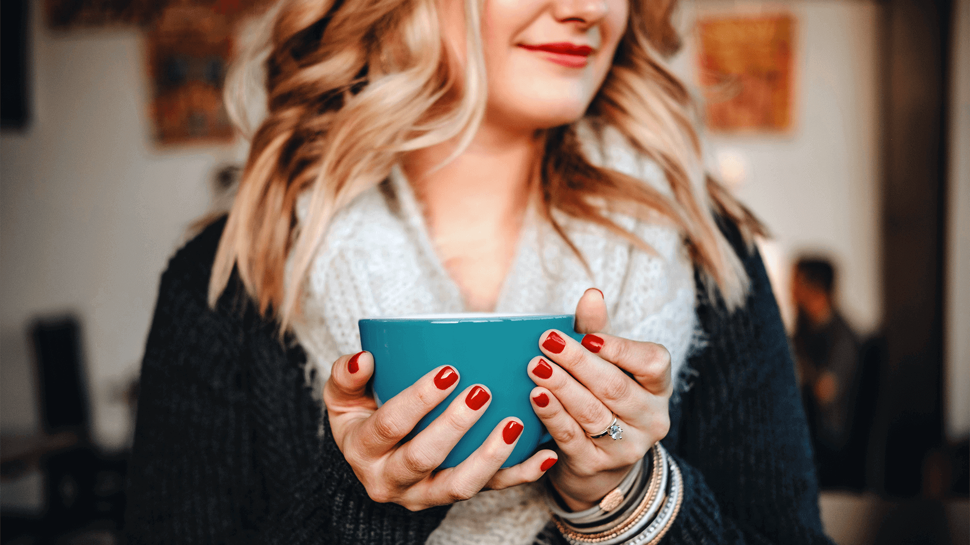 Smiling woman holding coffee cup