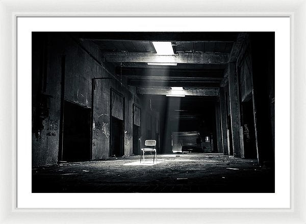 Abandoned Factory With Chair In Spotlight, Black and White - Framed Print from Wallasso - The Wall Art Superstore