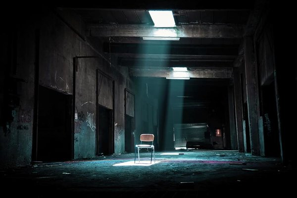 Abandoned Factory With Chair In Spotlight, Color - Art Print from Wallasso - The Wall Art Superstore