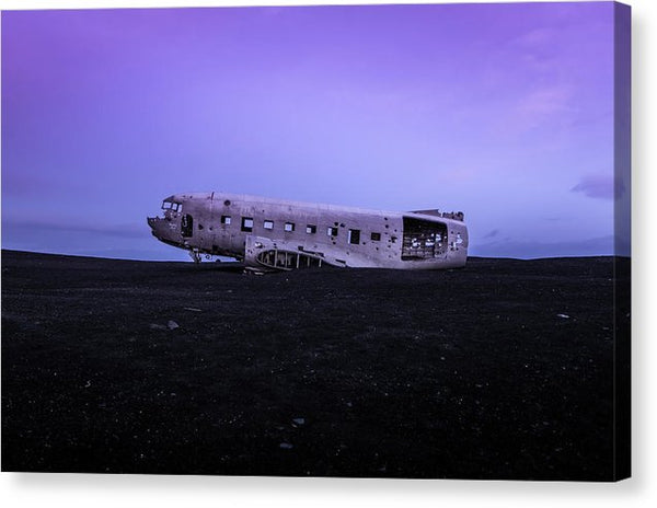 Airplane Wreckage Abandoned In Iceland With Purple Sky - Canvas Print from Wallasso - The Wall Art Superstore