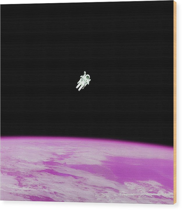 Astronaut Floating High Above Pink Pop Art Planet Earth - Wood Print from Wallasso - The Wall Art Superstore