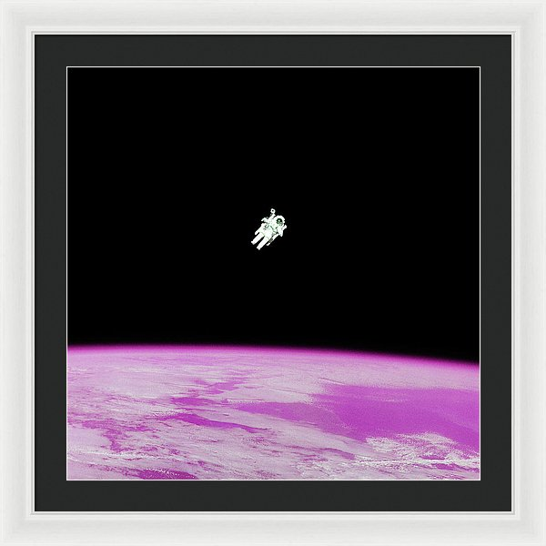Astronaut Floating High Above Pink Pop Art Planet Earth - Framed Print from Wallasso - The Wall Art Superstore