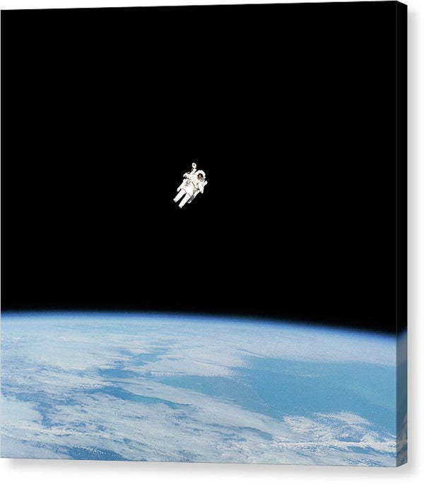 Astronaut Floating High Above Planet Earth - Canvas Print from Wallasso - The Wall Art Superstore