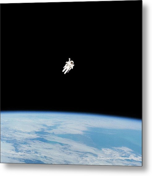 Astronaut Floating High Above Planet Earth - Metal Print from Wallasso - The Wall Art Superstore