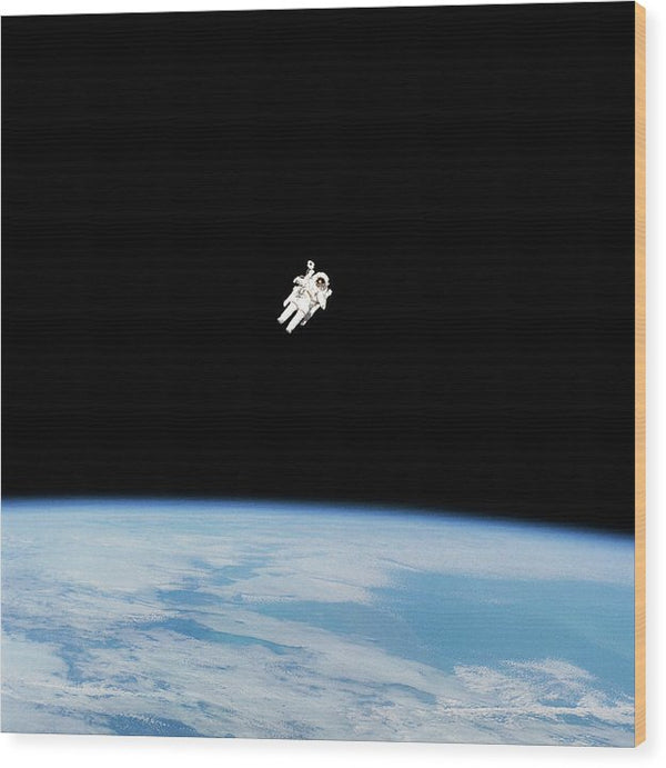 Astronaut Floating High Above Planet Earth - Wood Print from Wallasso - The Wall Art Superstore