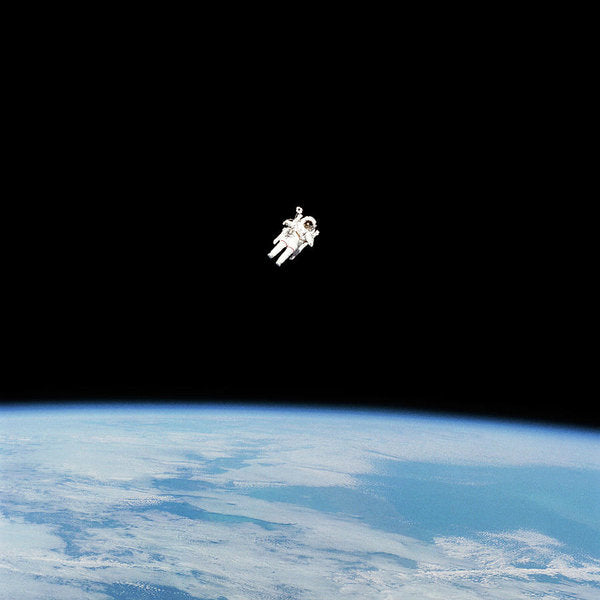 Astronaut Floating High Above Planet Earth - Art Print from Wallasso - The Wall Art Superstore
