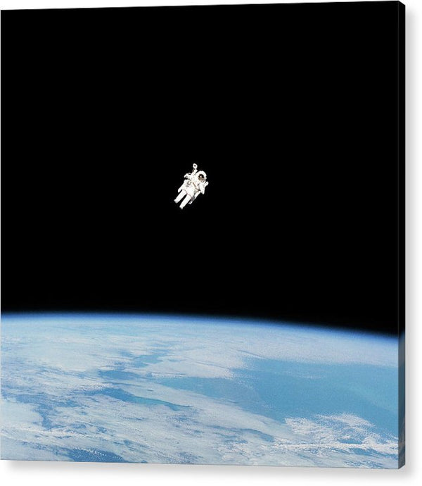 Astronaut Floating High Above Planet Earth - Acrylic Print from Wallasso - The Wall Art Superstore