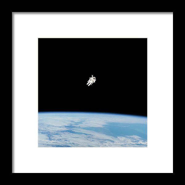 Astronaut Floating High Above Planet Earth - Framed Print from Wallasso - The Wall Art Superstore