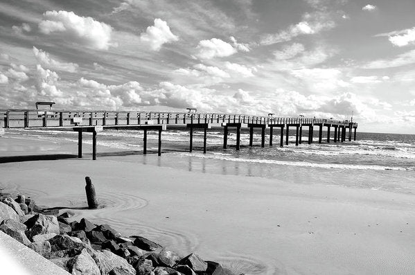 Black and White Pier With Fluffy Clouds In The Sky - Art Print from Wallasso - The Wall Art Superstore