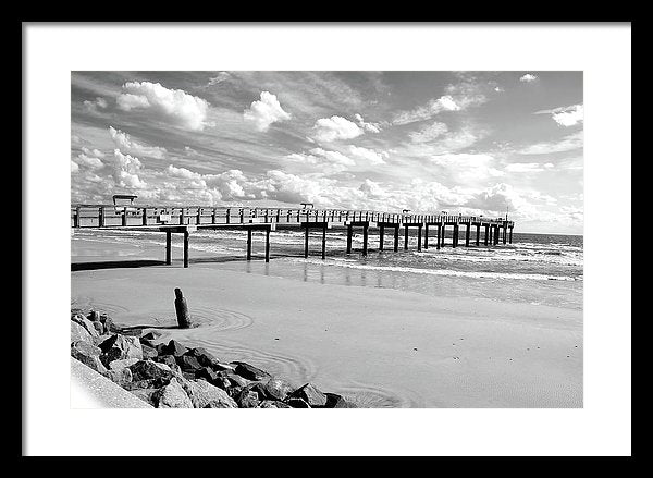 Black and White Pier With Fluffy Clouds In The Sky - Framed Print from Wallasso - The Wall Art Superstore