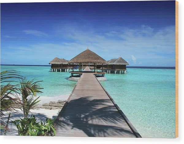 Boardwalk To Tropical Huts Over Crystal Blue Water - Wood Print from Wallasso - The Wall Art Superstore