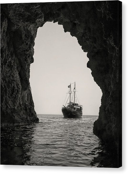 Boat Seen Through Beach Cave - Canvas Print from Wallasso - The Wall Art Superstore