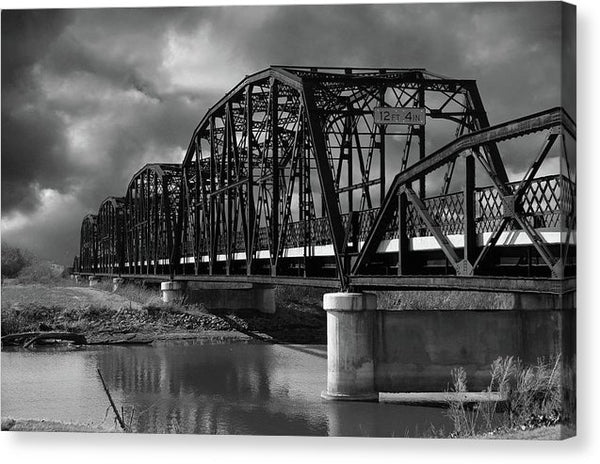 Bridge Over River With Storm Clouds - Canvas Print from Wallasso - The Wall Art Superstore