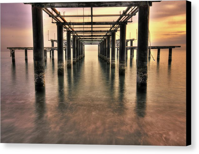 Brilliant Sky Behind Rusty Remains of Old Pier - Canvas Print from Wallasso - The Wall Art Superstore