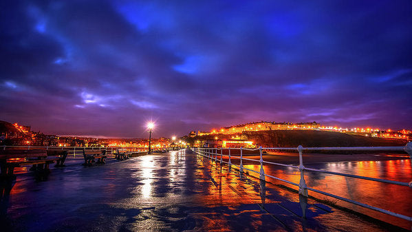 City Lights At Night Reflected On Wet Pier - Art Print from Wallasso - The Wall Art Superstore