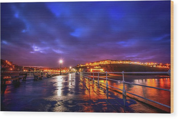 City Lights At Night Reflected On Wet Pier - Wood Print from Wallasso - The Wall Art Superstore
