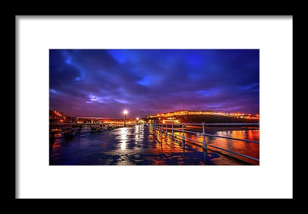 City Lights At Night Reflected On Wet Pier - Framed Print from Wallasso - The Wall Art Superstore