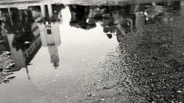 City Reflected In Rain Puddle - Art Print from Wallasso - The Wall Art Superstore