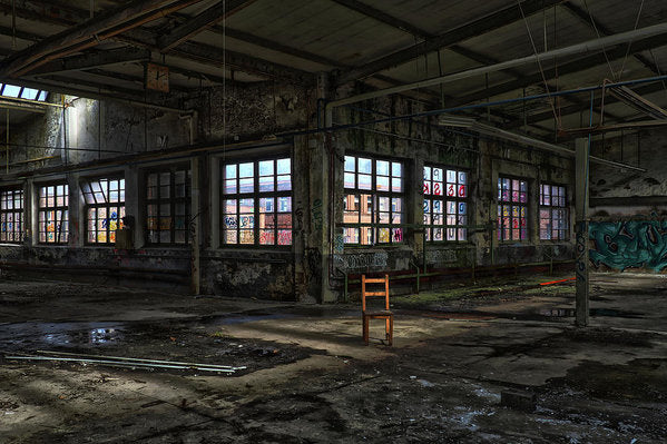 Colorful Abandoned Factory With Single Brown Chair - Art Print from Wallasso - The Wall Art Superstore