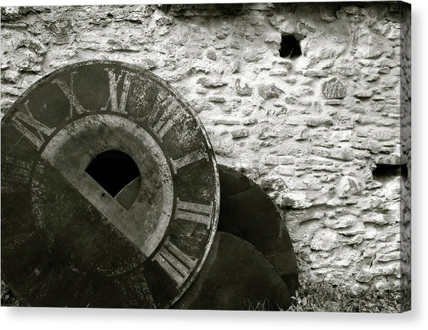 Distressed Clock Face Leaning Against Stone Wall - Canvas Print from Wallasso - The Wall Art Superstore