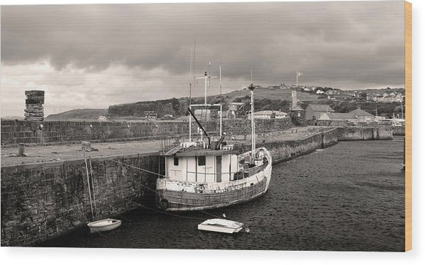 Fishing Boat Docked To Stone Pier - Wood Print from Wallasso - The Wall Art Superstore