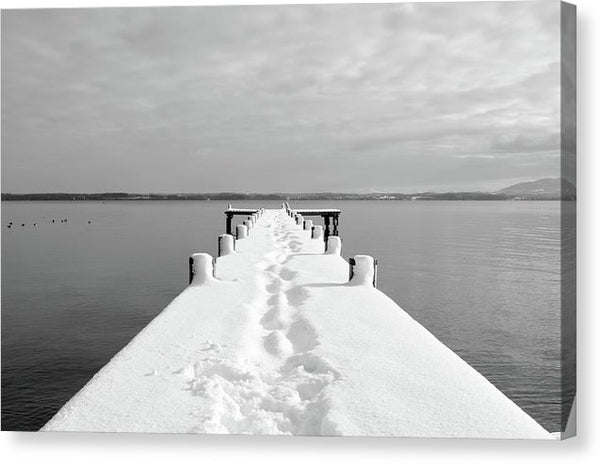 Footprints On Snowy Lakeside Dock - Canvas Print from Wallasso - The Wall Art Superstore