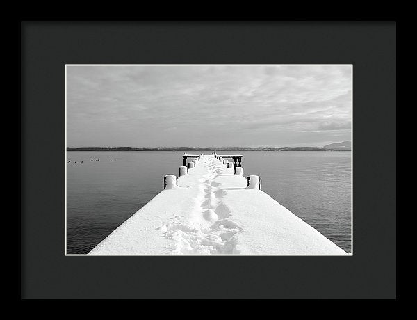 Footsteps On Snowy Dock - Framed Print from Wallasso - The Wall Art Superstore