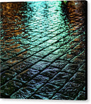 Green City Lights At Night Reflected On Wet Cobblestone - Canvas Print from Wallasso - The Wall Art Superstore