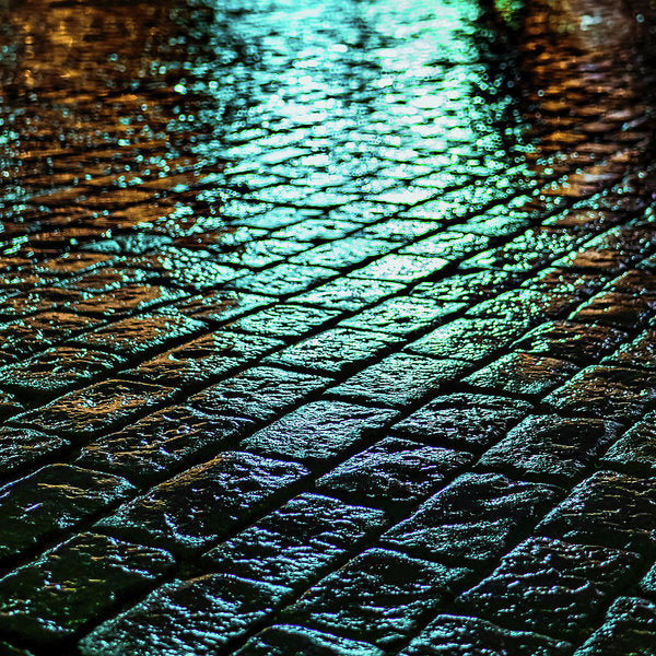 Green City Lights At Night Reflected On Wet Cobblestone - Art Print from Wallasso - The Wall Art Superstore