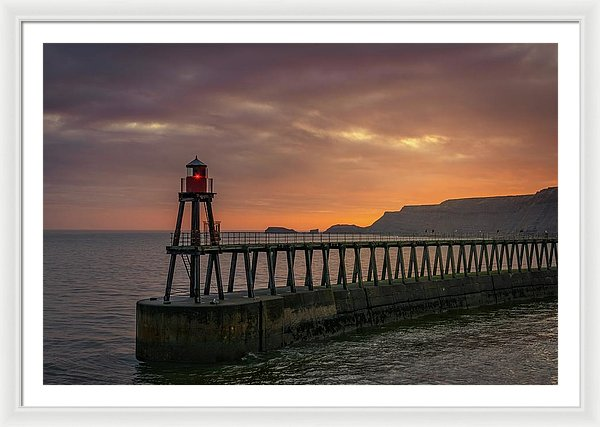 Lighthouse On Whitby Pier Jetty At Sunset - Framed Print from Wallasso - The Wall Art Superstore