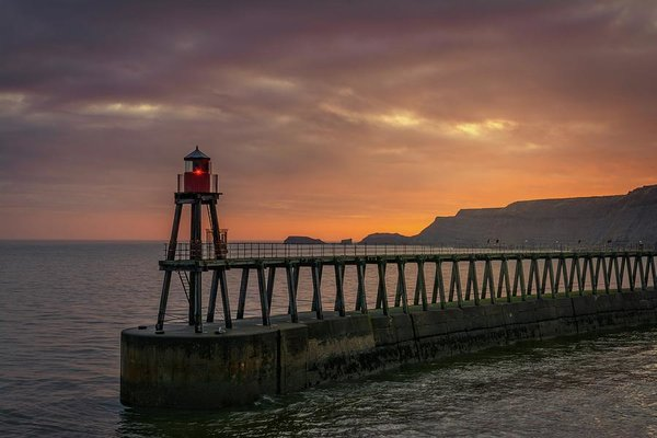 Lighthouse On Whitby Pier Jetty At Sunset - Art Print from Wallasso - The Wall Art Superstore