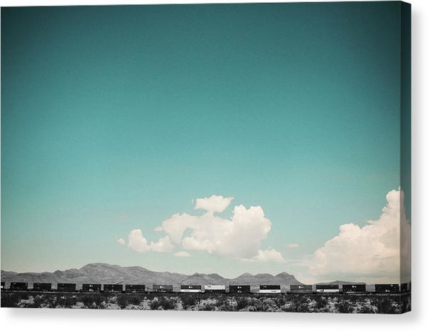 Long Desert Train Under Blue Sky - Canvas Print from Wallasso - The Wall Art Superstore