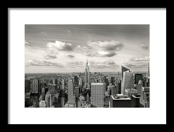 Manhattan Skyscrapers With Clouds, New York City - Framed Print from Wallasso - The Wall Art Superstore