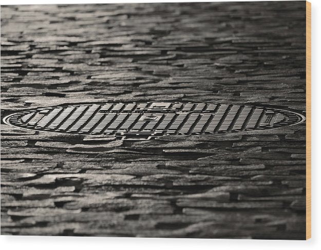 Manhole Cover In City Street - Wood Print from Wallasso - The Wall Art Superstore