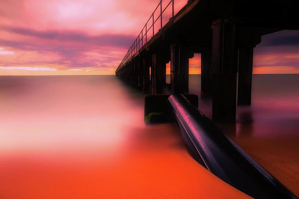 Pier With Vibrant Orange Color - Art Print from Wallasso - The Wall Art Superstore