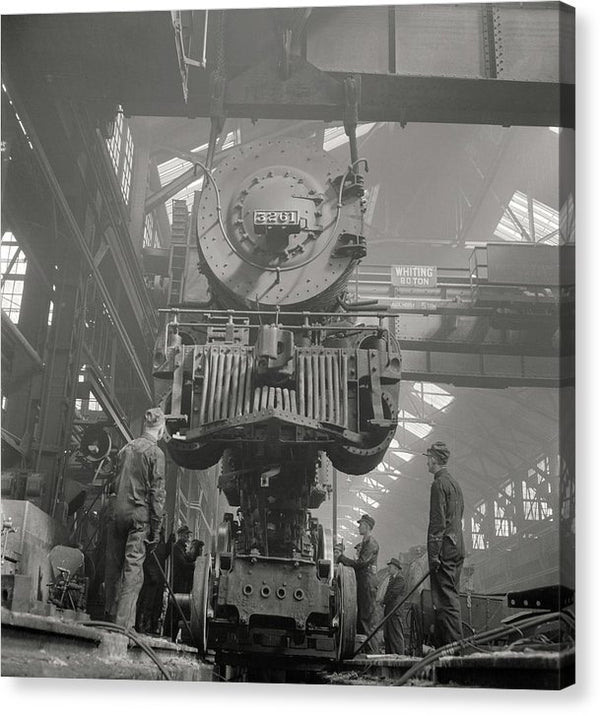 Putting Wheels On Antique Locomotive Engine, 1943 - Canvas Print from Wallasso - The Wall Art Superstore