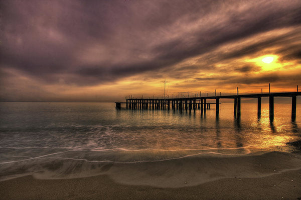 Remains of Old Pier As The Sun Goes Down - Art Print from Wallasso - The Wall Art Superstore