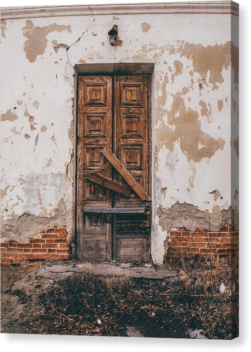 Rustic Wooden Door On Abandoned Building - Canvas Print from Wallasso - The Wall Art Superstore