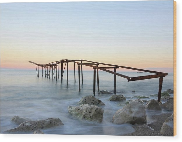 Rusty Metal Skeleton of Old Pier With Rocks - Wood Print from Wallasso - The Wall Art Superstore