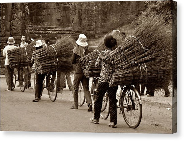 Transporting Sticks On Bicycle - Canvas Print from Wallasso - The Wall Art Superstore