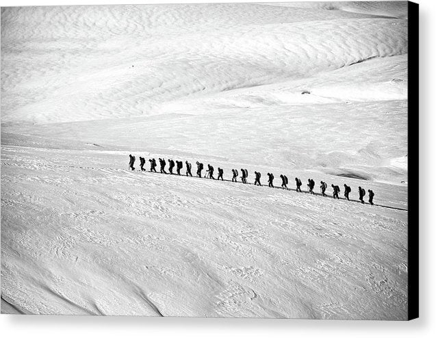 People Trekking Through Snow - Canvas Print from Wallasso - The Wall Art Superstore