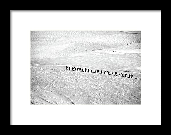 People Trekking Through Snow - Framed Print from Wallasso - The Wall Art Superstore