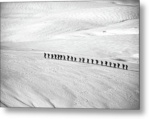 People Trekking Through Snow - Metal Print from Wallasso - The Wall Art Superstore